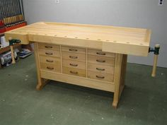 European style workbench with shaker cabinets.
