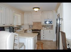 Microwave and counter idea. Beautiful Custom Cabinets including Marble!