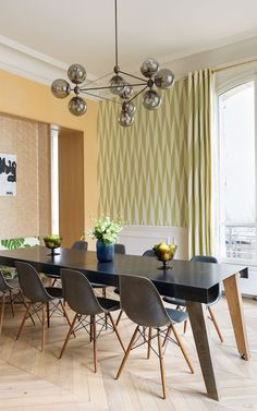 Chairs are by Charles & Ray Eames and the Modo chandelier is by Jason Miller