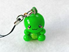 Kawaii Dinosaur Charm with Cell Phone Strap. via Etsy.