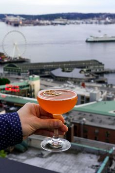 Rooftop bars in Seattle with killer views and cocktails. From Seattle hotel bars to Seattle breweries, here are the best Seattle rooftop bars you need to try! #seattlerooftopbar #seattlerooftopdeck #seattlerooftoprestaurant #seattlerestaurantswithaview #seattlecocktailbar #seattlebars #bestbarsinseattle #seattlebarsdowntown #placestodrinkinseattle