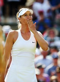 Maria Sharapova of Russia blows a kiss to the fans after winning her Ladies' Singles first round match against against Samantha Murray of Great Britain on day two of the Wimbledon Lawn Tennis Championships at the All England Lawn Tennis and Croquet Club at Wimbledon on June 24, 2014 in London, England. (Photo by Jan Kruger/Getty Images)