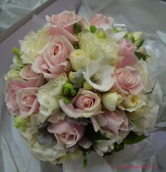 BG85 `Bianca candy` roses, cream spray roses, ivory lisianthus, white freesias and silver dust foliage