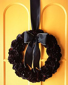DIY from Martha Stewart. I like the idea of a mourning wreath for All Souls Day.  This is silk roses spray painted black with floral spray paint and glued to a pressed wood craft wreath.