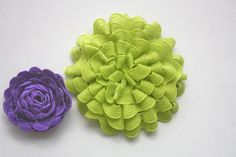 Rick Rack Flower  These felt backed rickrack flowers require only a simple running stitch to pull them together and are super cute for hairclips, headbands, clothing accents or gifts.
