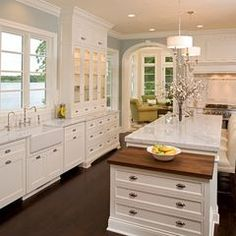 Floor to ceiling cabinets with upper glass doors from Grandparents farmhouse - North wall of kitchen