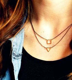 Geometric Brass Charm Necklaces – Set of 2 by Thorn & Wynn on Scoutmob Shoppe. Each of these two geometric charm necklaces features a delicate gunmetal chain with a small brass charm – one square and one triangle.