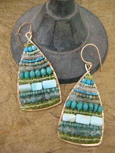Wrapped wire, these are pretty and most likley a great use of the random leftover beads in your stash!