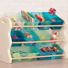 B. neat B. tidy B. roomy B. organized B. you<br>creating places for kids to do and discover, make and master, work and wonder.<br>Sortable bins for all your things! Tuck it away at the end of the day! Toys not included.