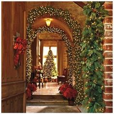 Arches of greenery, twinkle lights and a gorgeous tree - pure beauty!