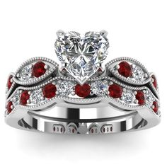 This is beautiful     white-gold-heart-white-diamond-engagement-wedding-ring-red-ruby-in-pave-set-FDENS3053HTGRUDRANGLE5-NL-WG