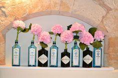 Bombay Sapphire and Hendrick's Gin Bottles filled with pale pink Hydrangea stems at Farnham Castle Weddings (Gin Bottle Flower) Diy Wedding, Wedding Venues, Wedding Flowers, Wedding Day, Woodland Wedding, Garden Wedding, Wedding Dresses, Gin Bar, Hendrick's Gin