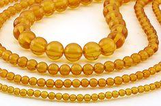 SmartyHands.com: Amber (medium color) round 10mm / 10 cm (10pc)