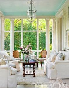 Painted ceilings in a sun room. Make your eyes go up, which makes the room feel bigger!