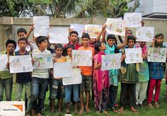 Children in #Bangladesh hold up their #drawings of their favourite #food during an art competition for World #Health Day.