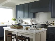 navy cabinets with marble backsplash