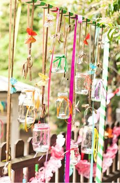 Recycle jam jars and ribbons for perfect for outdoor party decorations