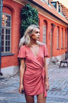 Grab a sun hat and sandals and jet-set off in the Vashti Rusty Rose Wrap Dress! Breezy woven rayon shapes this chic dress with a plunging neckline, darted bodice, and fluttering short sleeves. Tying, wrap skirt (with hidden internal button). As Seen On Marielle of @mariellelindahl!