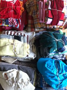 Selection of worn clothes for the striped Carpet of Life by trend researcher Hilde Roothart.