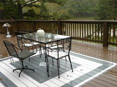 outdoor rug on wood deck deck paint ideas painted rug white gray how to paint wood deck porch furniture best outdoor rug for wooden deck Painted Wood Deck, Painted Porch Floors, Porch Flooring, Painted Rug, Outdoor Rugs, Outdoor Spaces, Outdoor Living, Outdoor Decor, Outdoor Projects