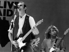 July 1985 - At Status Quo started the 'Live Aid' extravaganza, Status Quo Live, Rick Parfitt, Live Aid, Greatest Rock Bands, Wembley Stadium, Jfk, Lancaster, Cool Bands, Good Music