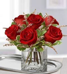 Our Rose Romance Valentine's floral arrangement will make your Valentine blush this February with a mixture of traditional red roses in a modern cube vase! $39.99 #wow #centerpieces #flowercenterpieces