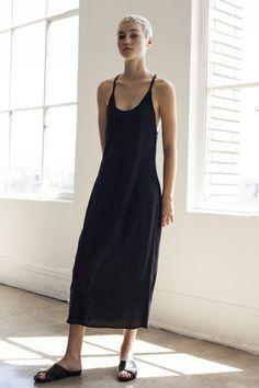 "From the Shaina Mote Core Collection, the Edin Dress is a mid length spaghetti strap dress with angled ""T"" strap in back and bias bound neck and arm. Linen Jersey Available in Ink"