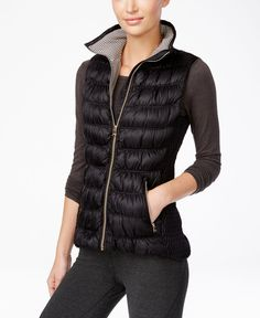 Layer on chic warmth with this Calvin Klein Performance puffer vest. Its sleek designer style moves easily from workouts to weekends. | Polyester/nylon; fill: down/waterfowl feathers | Machine washabl