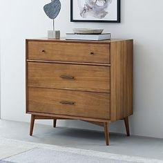 Our Mid-Century 3-Drawer Dresser is a roomy storage solution that's built to last—its sturdy frame is made from wood that's certified to Forest Stewardship Council® (FSC) standards. Its versatile size can serve as a small-space friendly…