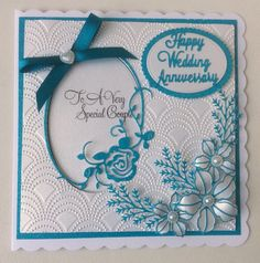 Creative Expressions Beaded Fanfare embossing folder. Oval Rose die from Rob Addams. Flowers and leaves from Sue Wilson. Ovals for sentiment by Tonic dies and sentiment dies from Die'sire. Stamp from Circadesign.co.uk.