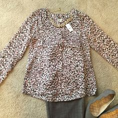 NWT! Very chic and unique patterned blouse This brand new blouse is super gorgeous and chic! Very unique pattern and can be dressed up or down! It is brownish-purple in color and looks great paired with any thing! Has buttons all the way down, and two pockets on each side! No collar. LOFT Tops