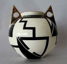 French-Art-Deco-vase-457x437 - Molded earthenware Art Deco vase, decorated with spherical, geometrized black graphics. Signed Fructuoso. 1930's (hva)