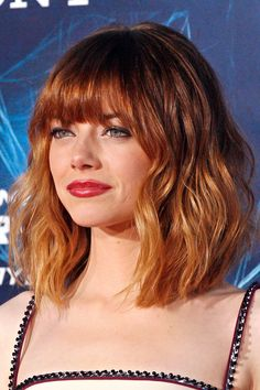 Emma Stone loves to switch up her colour, and we love this red ombre textured lob. The variations in colour add additional texture to this style.