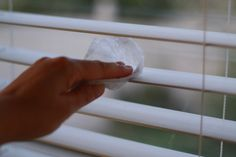 Using dryer sheets to clean window blinds