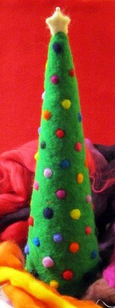 Wondering how to decorate a mantel for Christmas?  Why not create a Needle Felted Christmas Tree?  Better yet, make two or three of different sizes for a striking display.  Best of all, these homemade Christmas tree crafts won't shed pine needles!