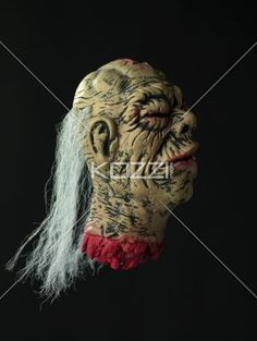 profile view of a scary demon. - Profile view of a scary demon over black background.