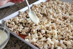 """I'll try anything with the word """"snickerdoodle"""" in it! Snickerdoodle Popcorn with white chocolate drizzle Popcorn Snacks, Salty Snacks, Popcorn Recipes, Snack Recipes, Dessert Recipes, Popcorn Kernels, Flavored Popcorn, Popcorn Bar, Appetizer Recipes"""