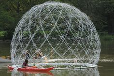 A Floating Orb Fashioned from Hundreds of Discarded Umbrella Frames