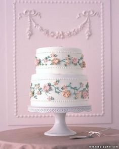 A garden of roses in pink, peach, and yellow encircles a full-size cake. The flowers' variegated look is achieved by placing two colors of icing side by side in the pastry bag. Rows of dots are piped in the same buttercream that covers the tiers. Bolo Floral, Floral Cake, Floral Wedding Cakes, Wedding Cakes With Flowers, Flower Cakes, Cake Wedding, Wedding Vows, Purple Wedding, Gold Wedding
