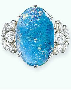 AN OPAL AND DIAMOND RING, BY CARTIER  The oval-shaped black opal to the marquise and brilliant-cut diamond cluster shoulders and plain hoop, circa 1970 Signed Cartier