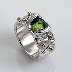 Unique two toned silver and gold natural peridot ring
