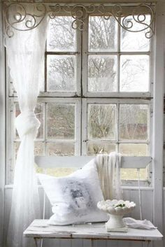 Shabby chic lace curtain.  Love the scroll work.