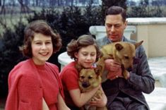 The photo shows a young, smiling, Princess Elizabeth with her sister and their father