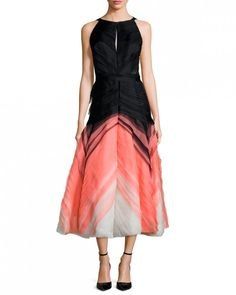 A pop of color in the midi-length A-skirt of this otherwise black dress brings in your palette while giving your MOB the comfort of an LBD.J.Mendel degrade pleated tulle halter dress, $5,900, bergdorfgoodman.com