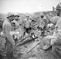 I died in hell – They called it Passchendaele — French soldiers bringing in a severely wounded...