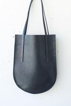 Black Leather Tote via studiobazar. Click on the image to see more!