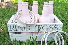 What could be more perfect for a wedding than a ring toss? Paint used bottles in your wedding colors, arrange in a wooden crate, and decorate embroidery hoops with pretty fabrics (get the how-to here).
