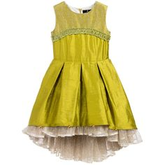 Girls raw silk green couture dress by Lazy Francis. This gorgeous design has a fitted sleeveless bodice, embellished with French lace and a smocked velvet trim. The skirt is full and pleated, and longer at the back, the hem is decorated with little bells, which tinkle when the child moves.<br /> Underneath, there are layers of French lace petticoats peeking out that create volume. The dress fastens at the back with a concealed zip and is lined for comfort.<br /> <br /> Model: Height 14...