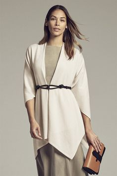 Made from thick, luxurious cashmere, this wrap-around piece is decidedly not your grandmother's shawl. With a yoked neck and tapered shape for easy, elegant draping, it'll keep you cozy without complicated knots or tucking.