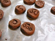 Roman Numeral clay coins and go-along book for ancient Rome. Could do sugar cookies?